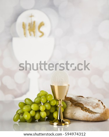 Holy communion a golden chalice, composition isolated on white #594974312