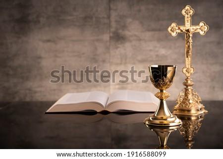 Holy communion. Catholic theme. Gray stone background. Stock photo ©