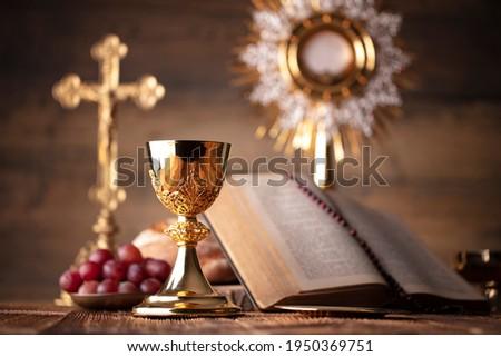 Holy communion. Catholic theme. Wooden background. Place for typography. Photo stock ©