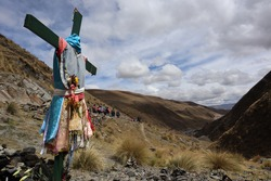 Holy cross from the peregrination in cusco peru, honoring to the señor de qoyllur rit'i, inka ceremony and procession nearby a glacier in south america, pilgrimage activity in beautiful nature