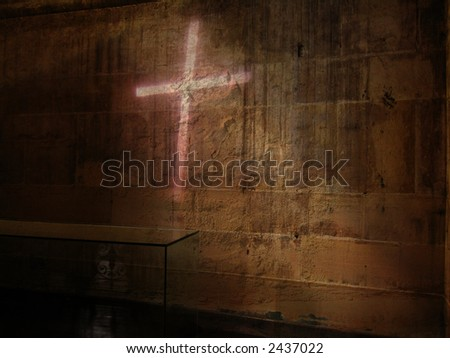 Holy Light Cross on the Dark Side of a Church Wall