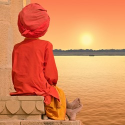 Holy man near Ganges in Varanasi, India.