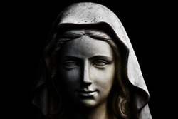 Holy Mary statue portrait isolated on black