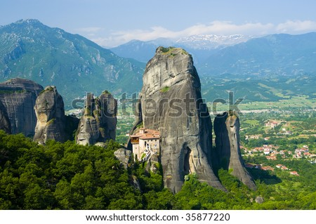 Holy Monastery of Rousanou with Snow capped Mountain in the background , Meteora, Greece