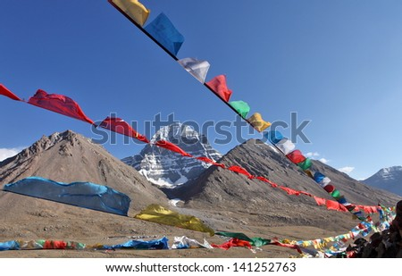 Holy Mount Kailash in Tibet and Buddhist prayer flags on foreground
