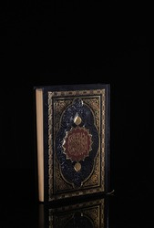 Holy Qur'an isolated black background