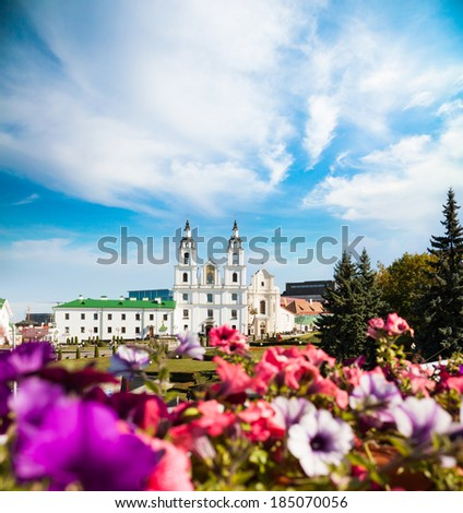 Holy Spirit Cathedral in Minsk, Belarus. View of Orthodox Church and Historical Center (Nemiga). Defocused Flowers on the Foreground.