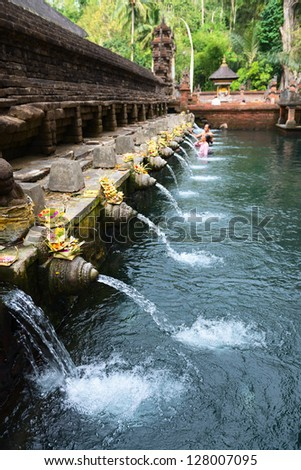 Holy spring water in Tirta Empul temple Bali Indonesia