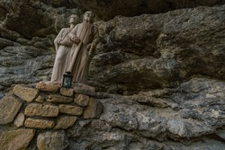 Holy stone statue in the Brother Klaus Grotto a pilgrimage site at Beuron Monastery in the Danube Valley in autumn