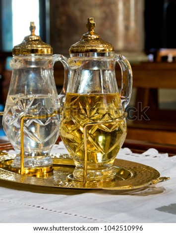 holy water and holy wine ready to turn into the blood of Jesus Christ during mass #1042510996