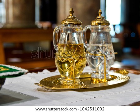 holy water and holy wine ready to turn into the blood of Jesus Christ during mass #1042511002