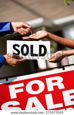 Home: Agent Hands Keys to new Homeowner