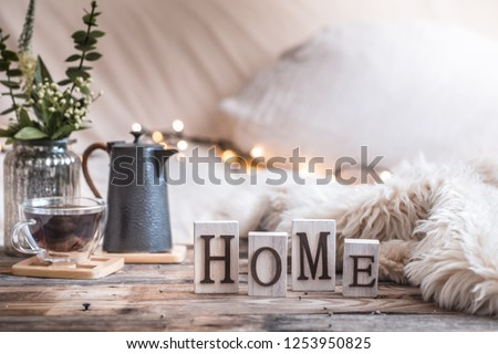 home atmosphere in the interior with wooden letters and home decor items, comfort concept