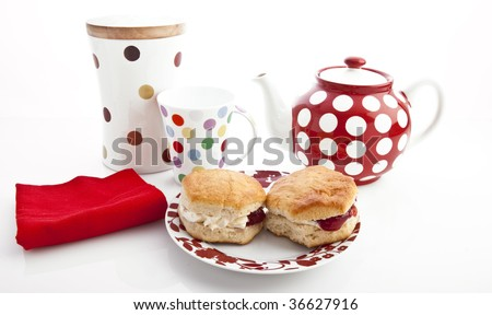 Home-baked scones with strawberry jam and clotted cream, often served with a cup of tea. Known as a cream tea.