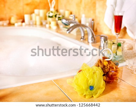 Home bathroom interior with bubble bath. - stock photo