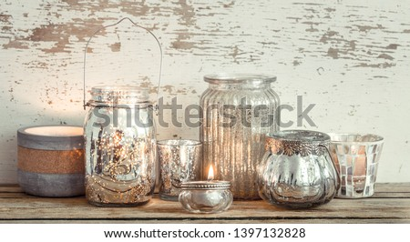 Home cozy beautiful decor, different vases and candles on a wooden background , the concept of interior details #1397132828