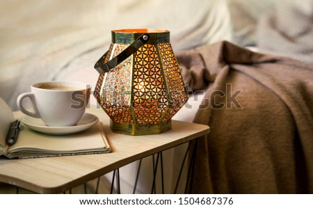 Home deco indoor with candle holder and coffee, cozy blanket ,cozy winter interior details #1504687376