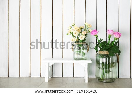 Home decor and roses on wooden background #319151420