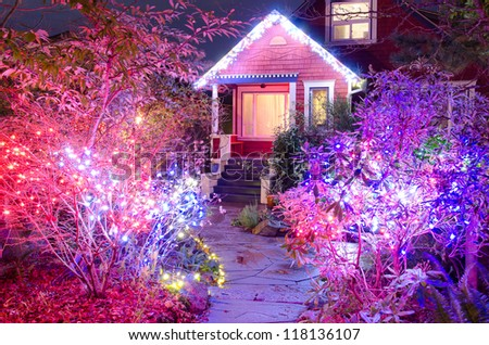 Home decorated and lighted for Christmas and for New Year Eve at Night at Vancouver, Canada.