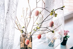 Home Easter decor with branches and eggs.
