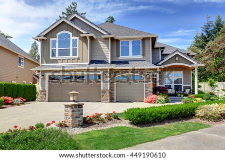 Home exterior with garage and driveway with nice landscaping desing around