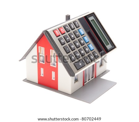 Home financing (cost of occupancy) concept - model of the house with calculator instead of the roof