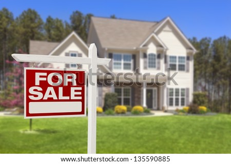 Home For Sale Real Estate Sign and Beautiful New House.