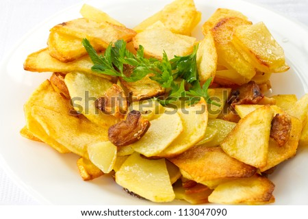 Home-fried potatoes with slices of bacon - stock photo