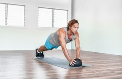 Home gym medicine ball workout abs exercise stability body exercises man training tricep pushups.