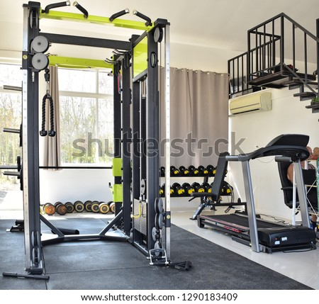 Home gym. Private gym at home, luxury, Small home gym With bench With dumbbells, Interior of New modern Equipment, apartment, different exercise Equipments, sport, Fitness, amateur home gym. Thailand.