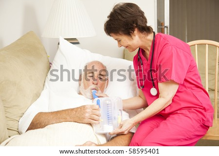 Home health nurse helps a senior patient with his respiratory therapy.