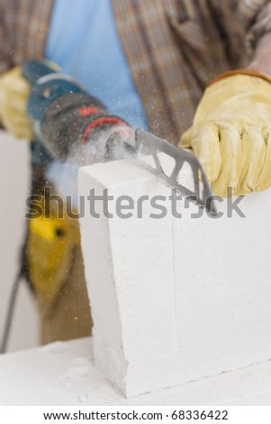Home improvement - handyman cut brick with saw, close-up