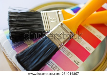 home improvement - painting walls with brushes and variety of colors