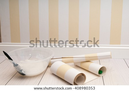 Home improvement scene of wallpaper being prepared to hang on the wall Stockfoto ©
