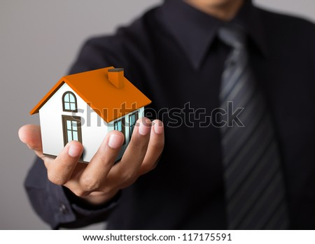 home in business man hand #117175591