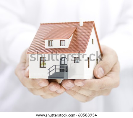 Home in hands - stock photo