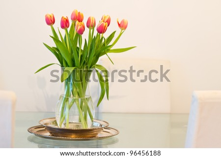 home interior decoration, vase of tulips on glass table