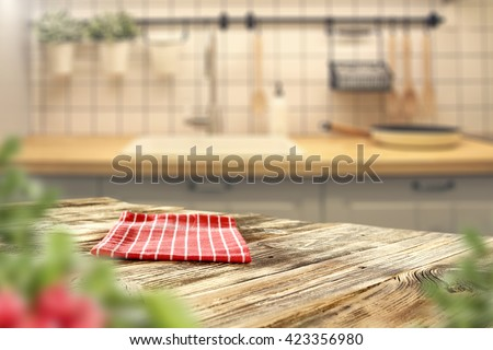 home interior of kitchen in brown colors and red napkin