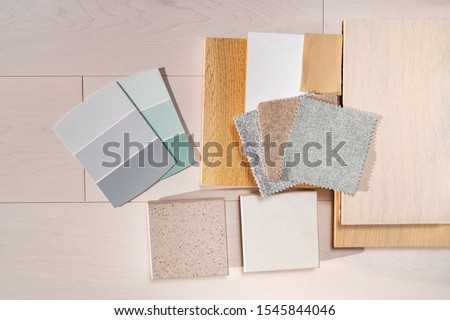 Home interior remodeling design colors choices. Color shades palette designer choice for renovation of kitchen, living room of apartment. Colour trends for wood flooring, quartz countertops, paint.