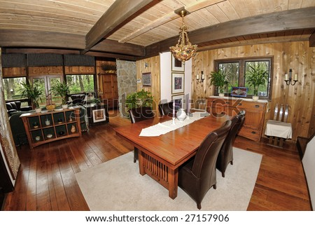 Home Interior shot of a dining room in a cedar log chalet home.