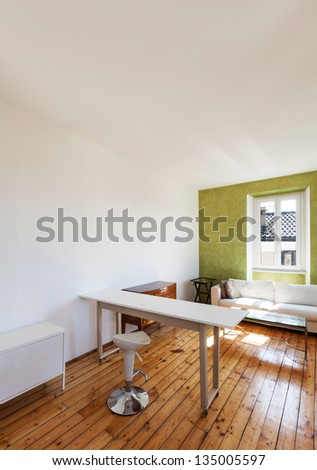 home interior, view of studio with white sofa and desk