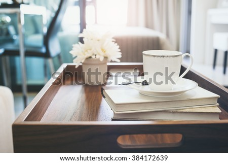 Home Interior with Coffee cup Books white flower on table wooden tray lifestyle background