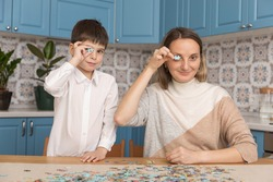 Home jigsaw puzzle. little boy and his mother playing
