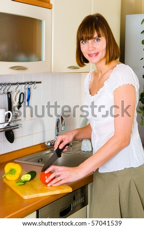 home life: woman preparing something to eat