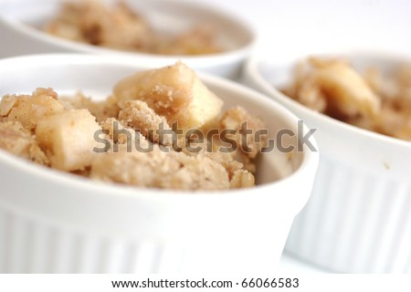 Home made apple crumble in white containers