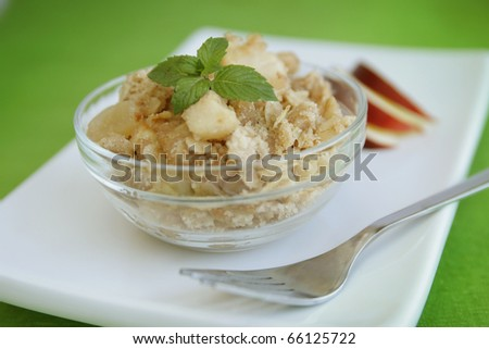 Home made apple crumble with mint in clear container