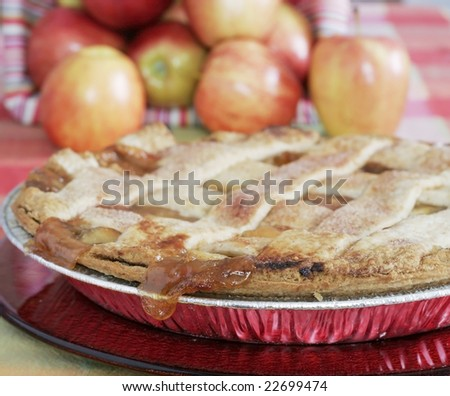 home made apple pie with apples in background