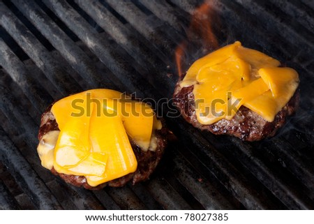 Home Made Cheeseburgers on Barbeque Grill