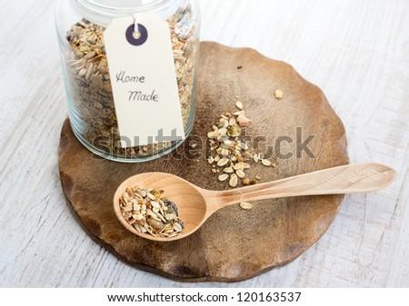 Home made crispy muesli on wooden board , selective focus