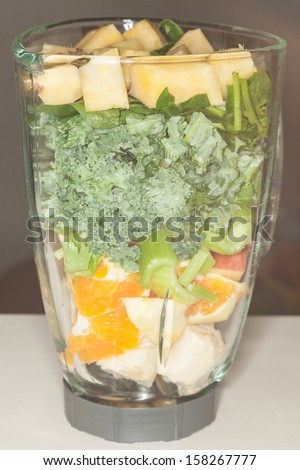 Home made fruit and vegetable smoothie blended from spinach, kale,celery, banana, orange, apple, pineapple and coconut juice.